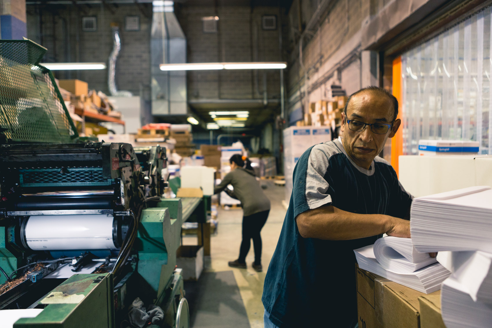 working gathering envelopes at printing press for washington dc industrial photography