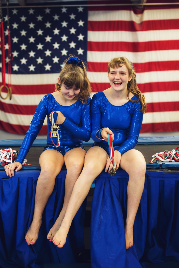 special olympics gymnast sisters sitting in front of american flag, washington dc commercial photography