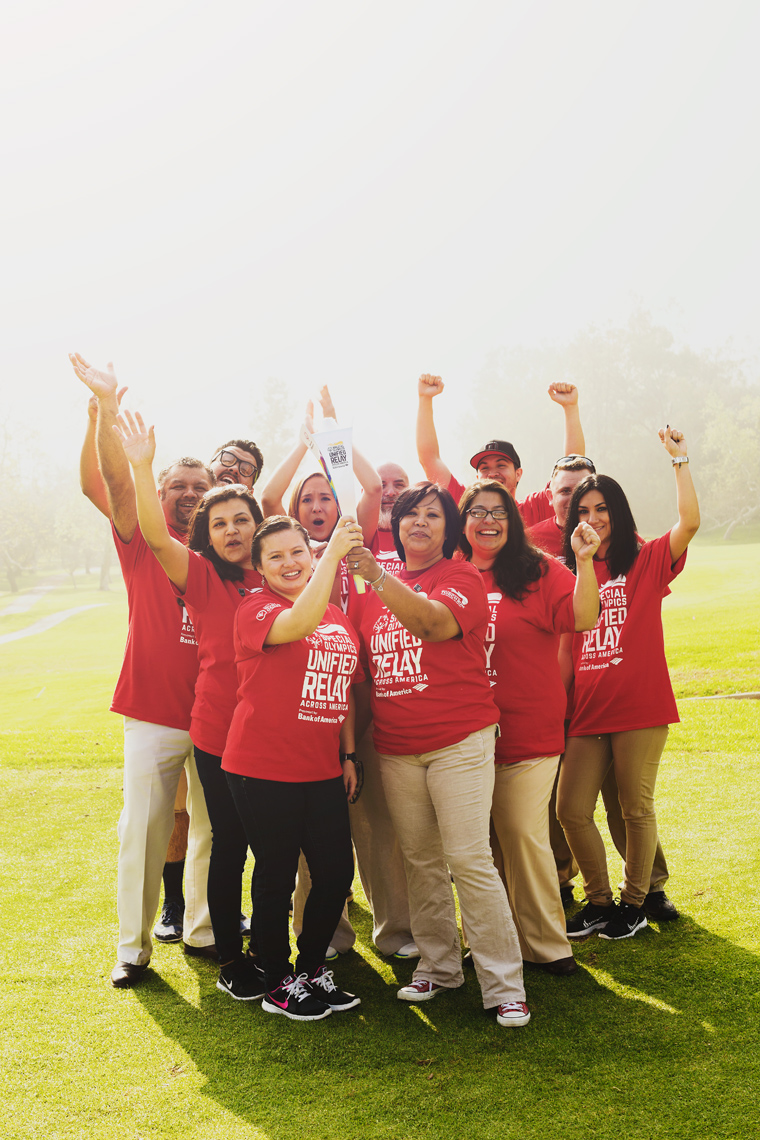 bank of america employees holding special olympics torch on golf course, washington dc commercial photography