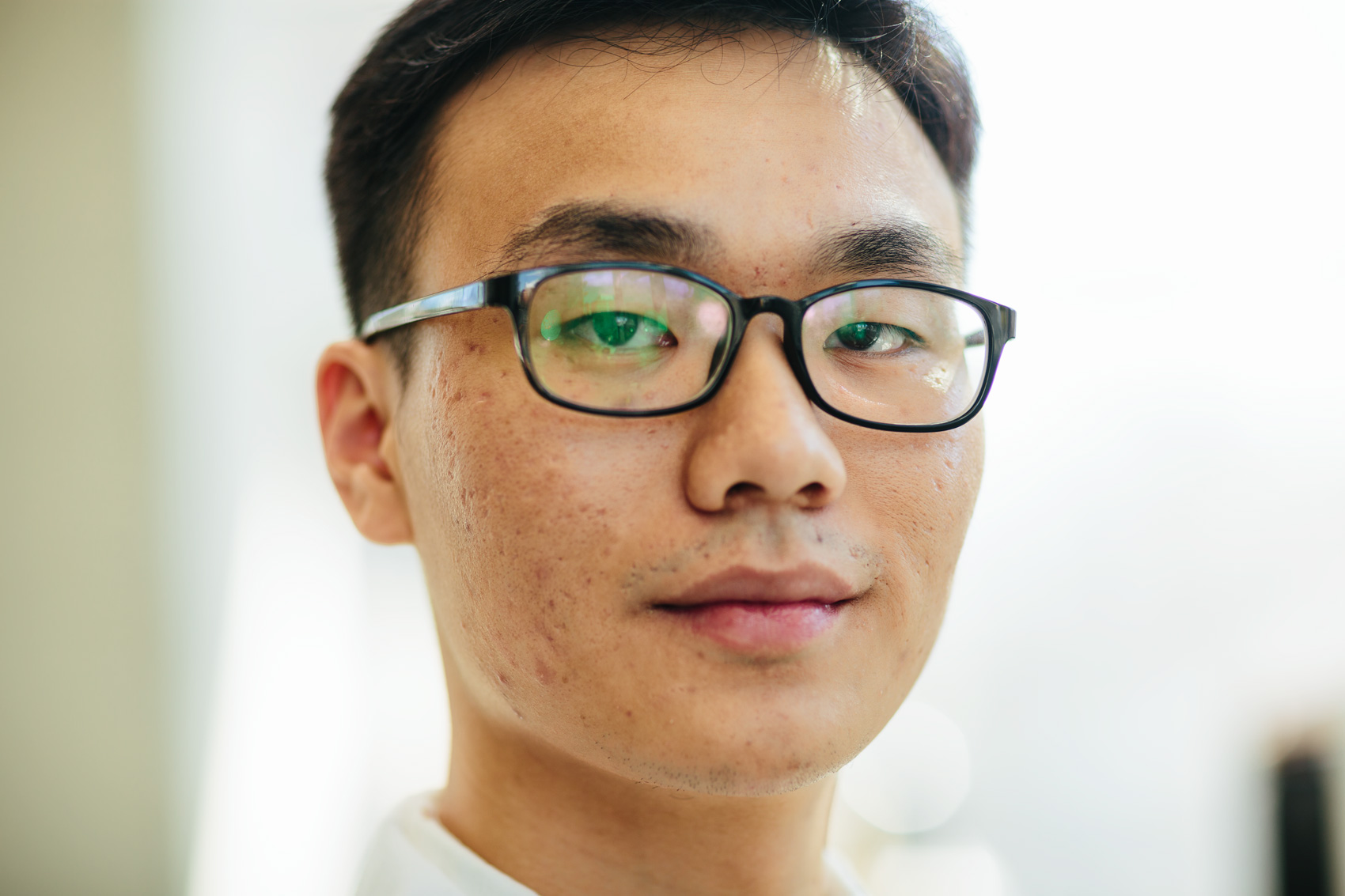 close portrait of student lab worker with glasses, washington dc portrait photography