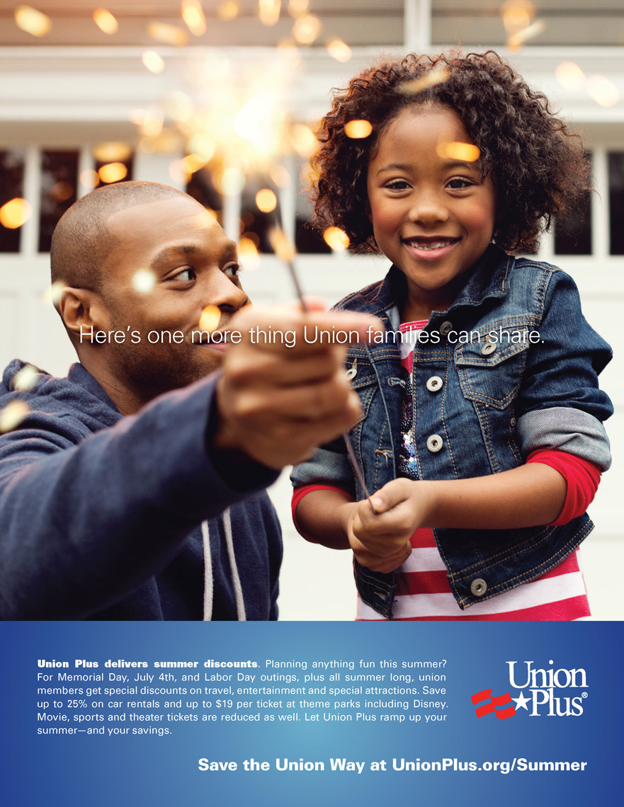 dad holding sparkler with daughter for union plus advertisement, washington dc commercial photography