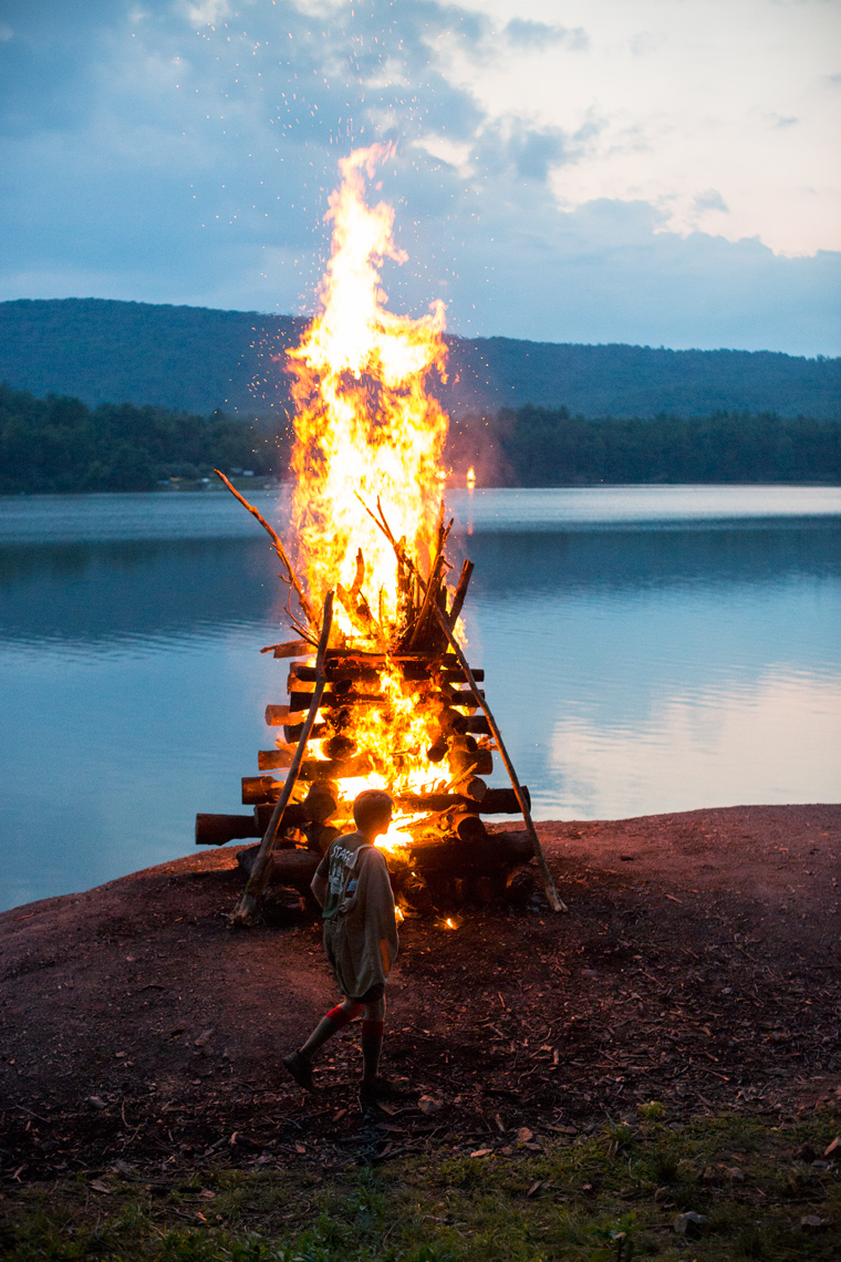 bonfire by a lake, washington dc photojournalism