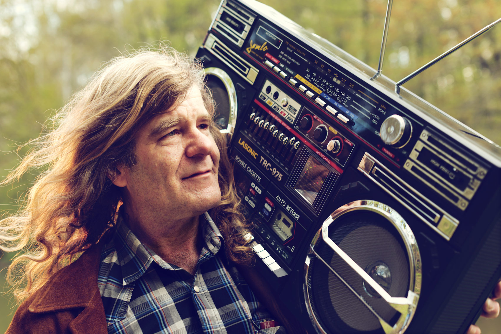 man with long hair holds boombox for washington dc editorial photography