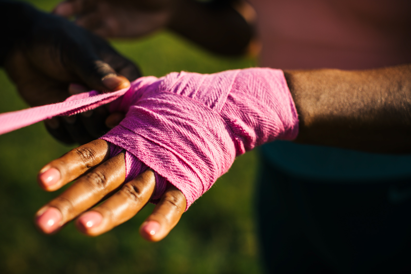 hands in pink boxing wraps for washington dc commercial photography