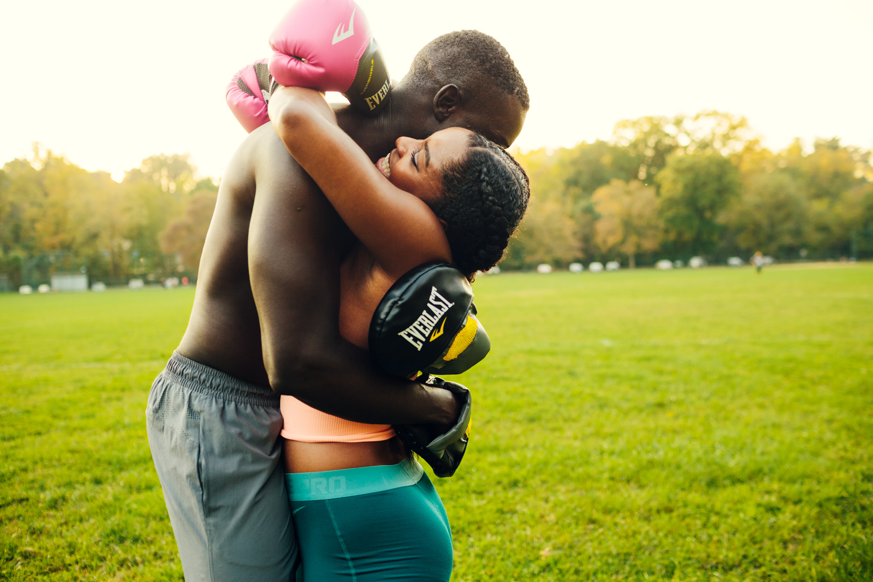 couple embracing after boxing practice for washington dc commercial photography