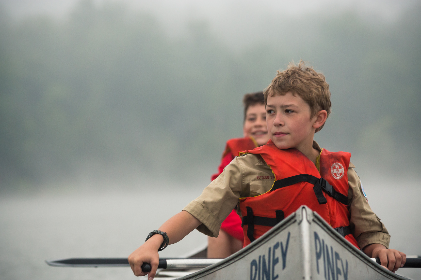 boy scouts in canoe in fog, washington dc photojournalism