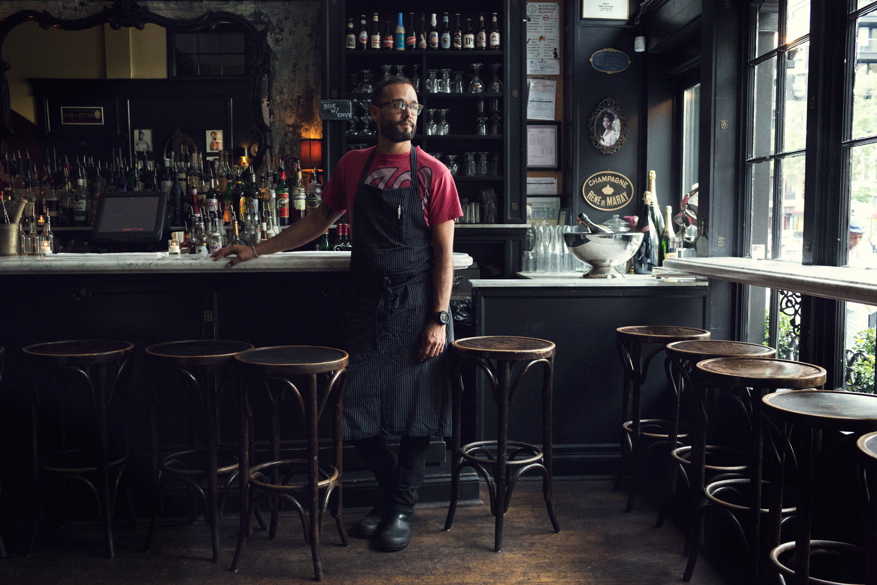 chef angel franco leaning on bar at marvin for washington dc portrait photography