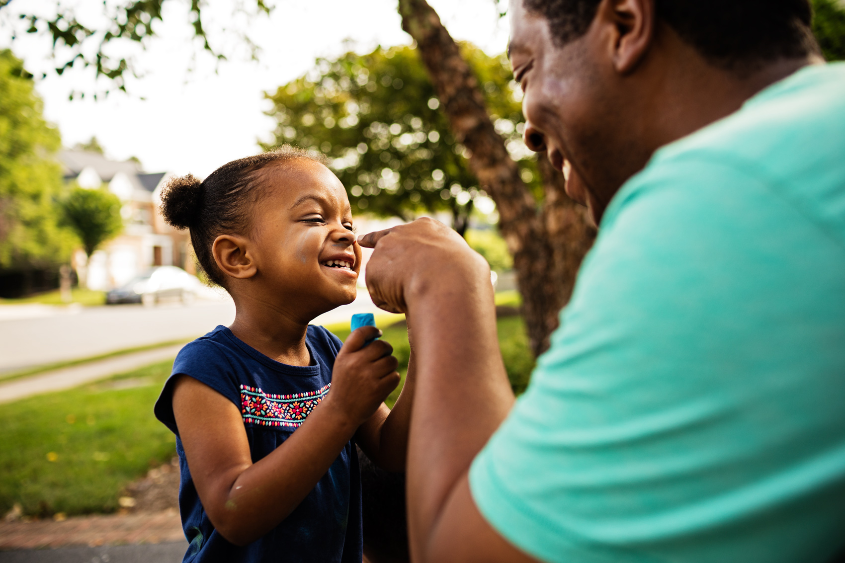 father pointing finger at laughing daughter, washington dc commercial photography