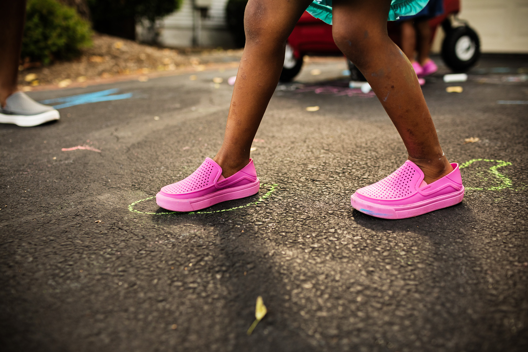 girl walking in pink crocs in driveway, washington dc commercial photography