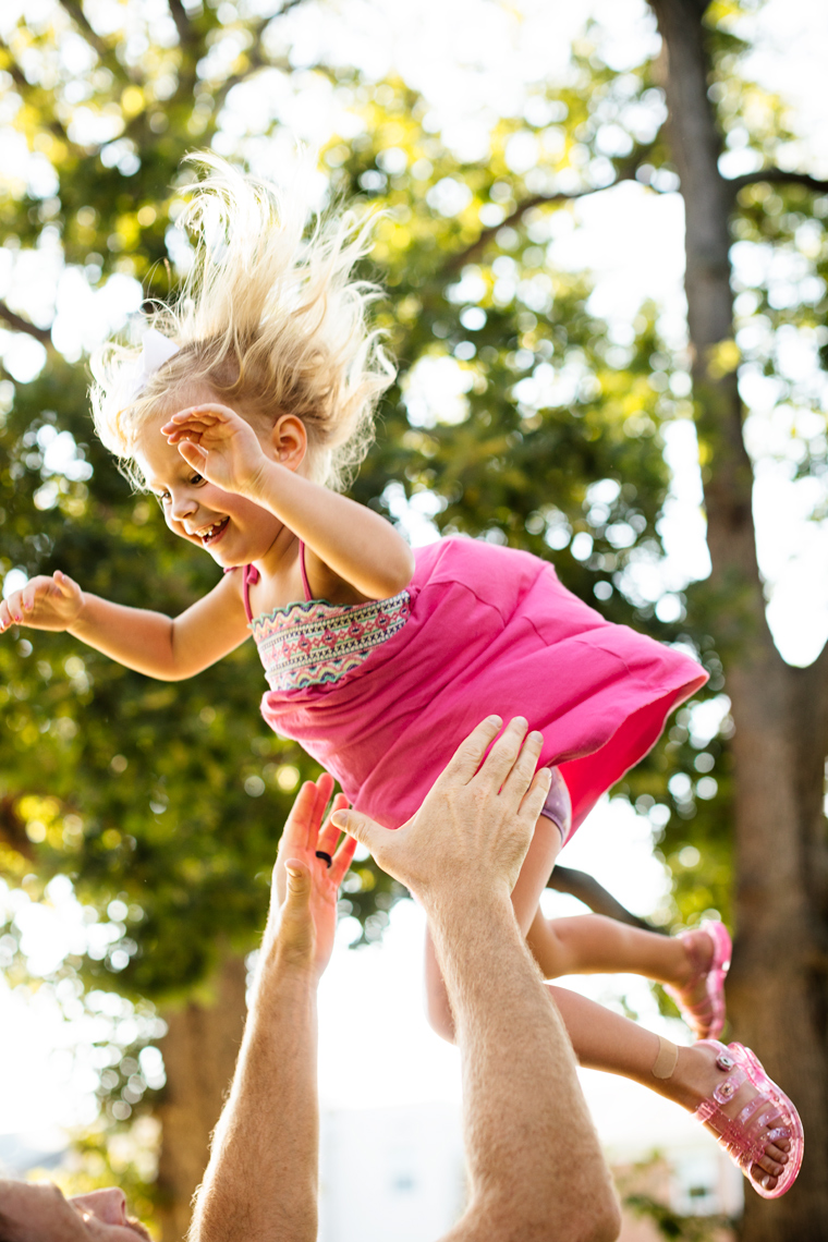 dad tossing daughter in trees, washington dc commercial photography