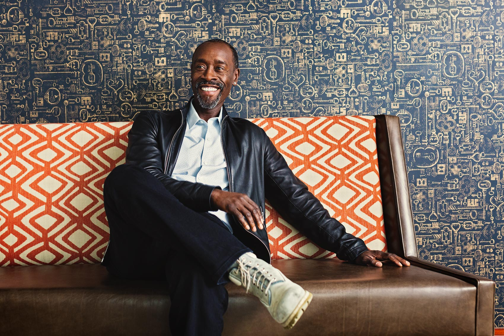 war machine actor don cheadle sitting on couch for washington dc celebrity photography