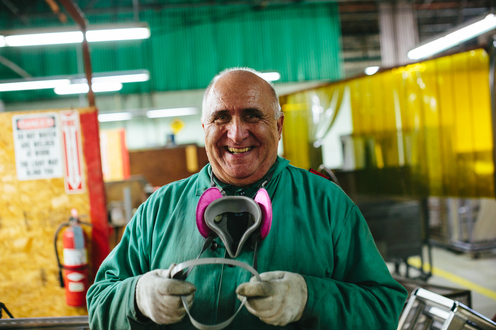 welder smiling in factory for washington dc editorial photography