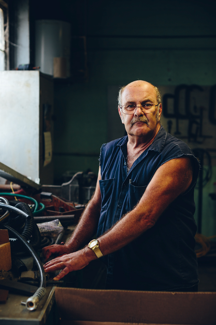sleeveless emeco factory worker posing for portrait for washington dc editorial photography