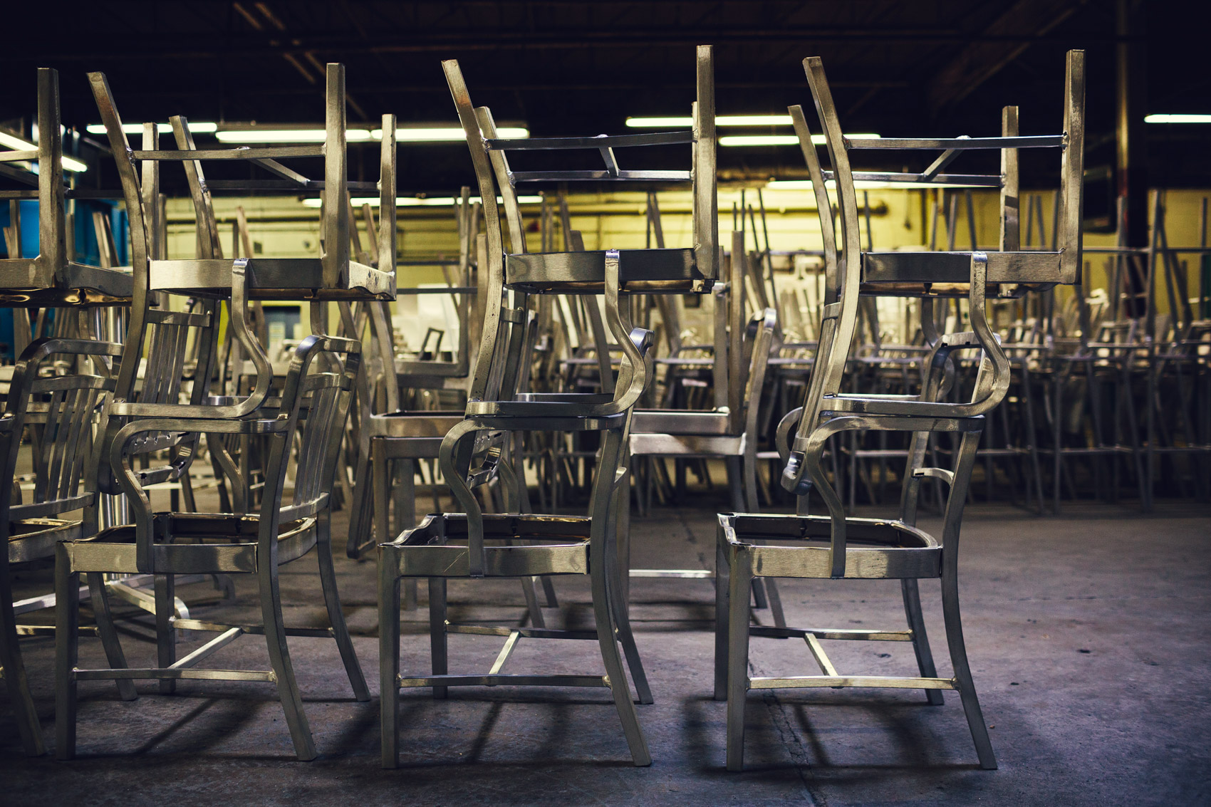 1006 navy chair factory stacked in factory for washington dc industrial photographer