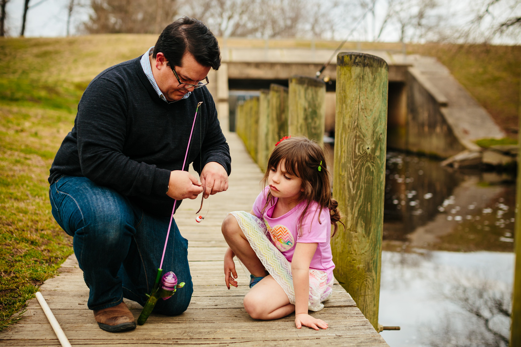 father hooking fish with daughter on dock, washington dc commercial photography