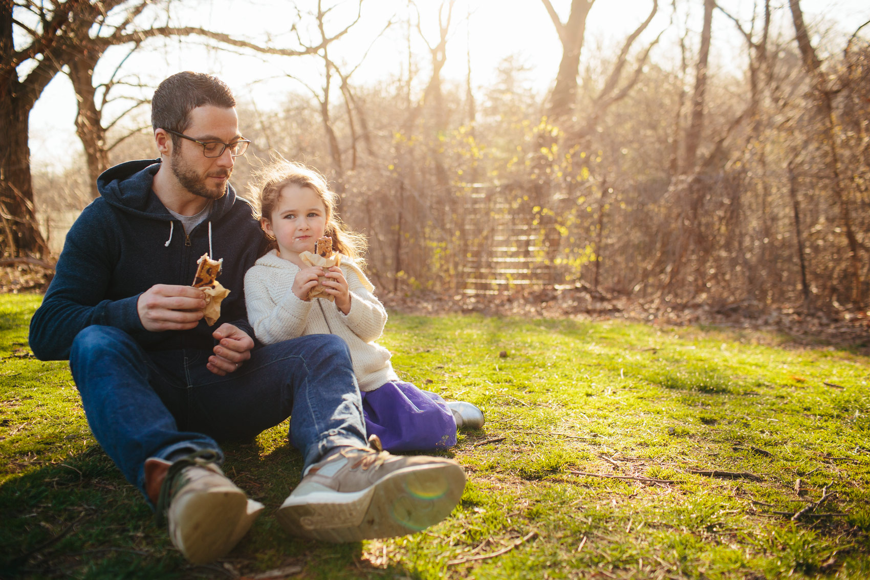 father and daughter eating ice cream sandwiches in park, washington dc commercial photography