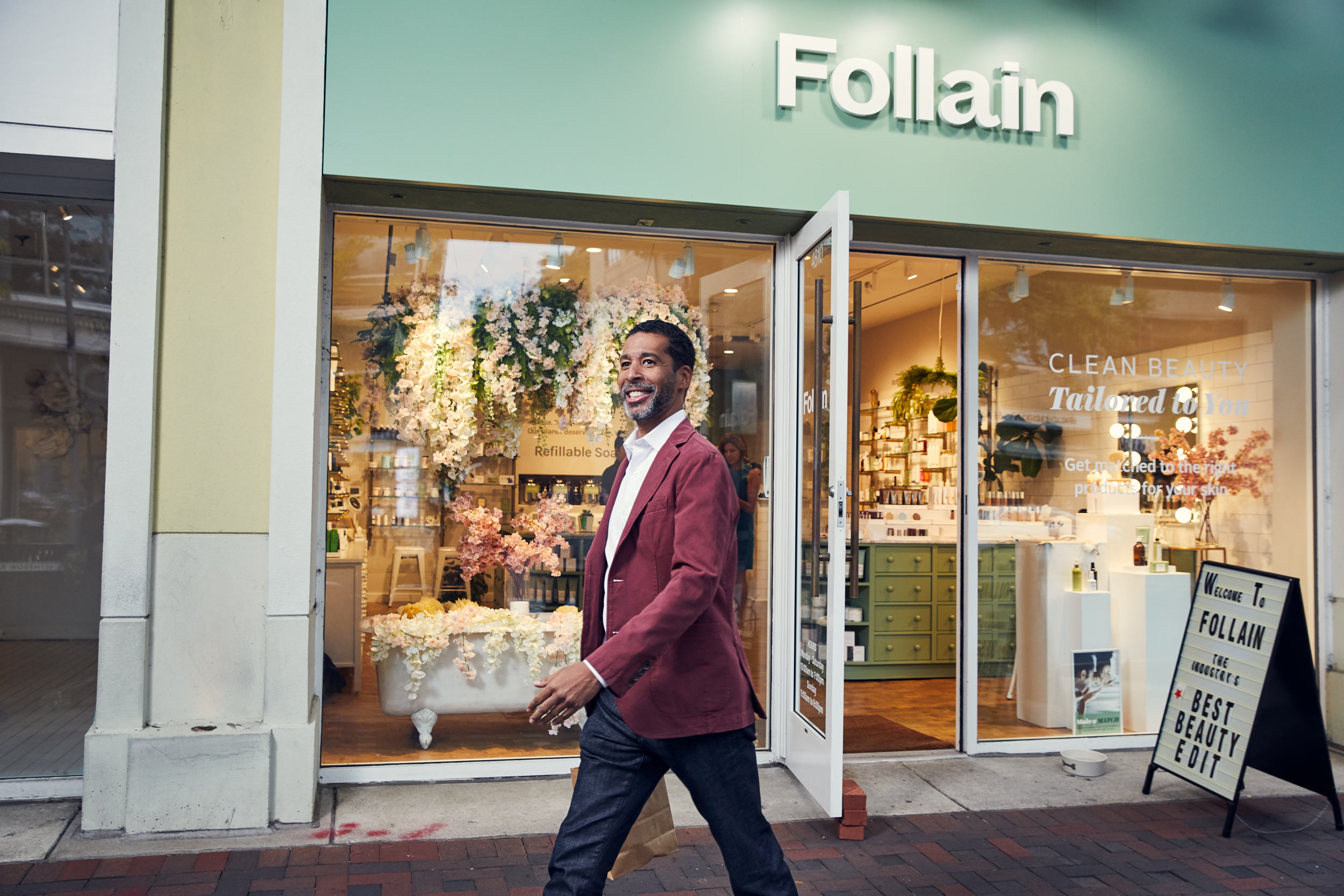 affluent man leaving store follain, washington dc commercial photography