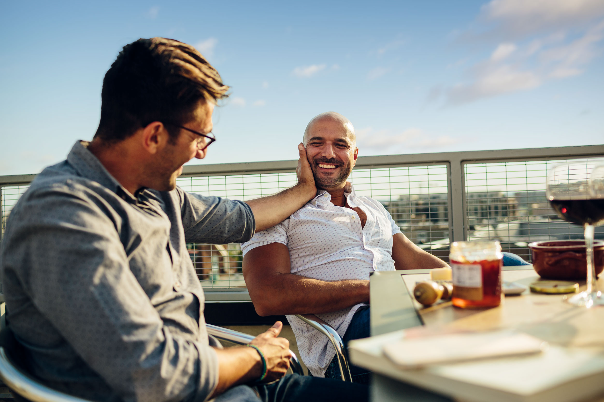 men eating cheese plate on rooftop for washington dc lifestyle photography