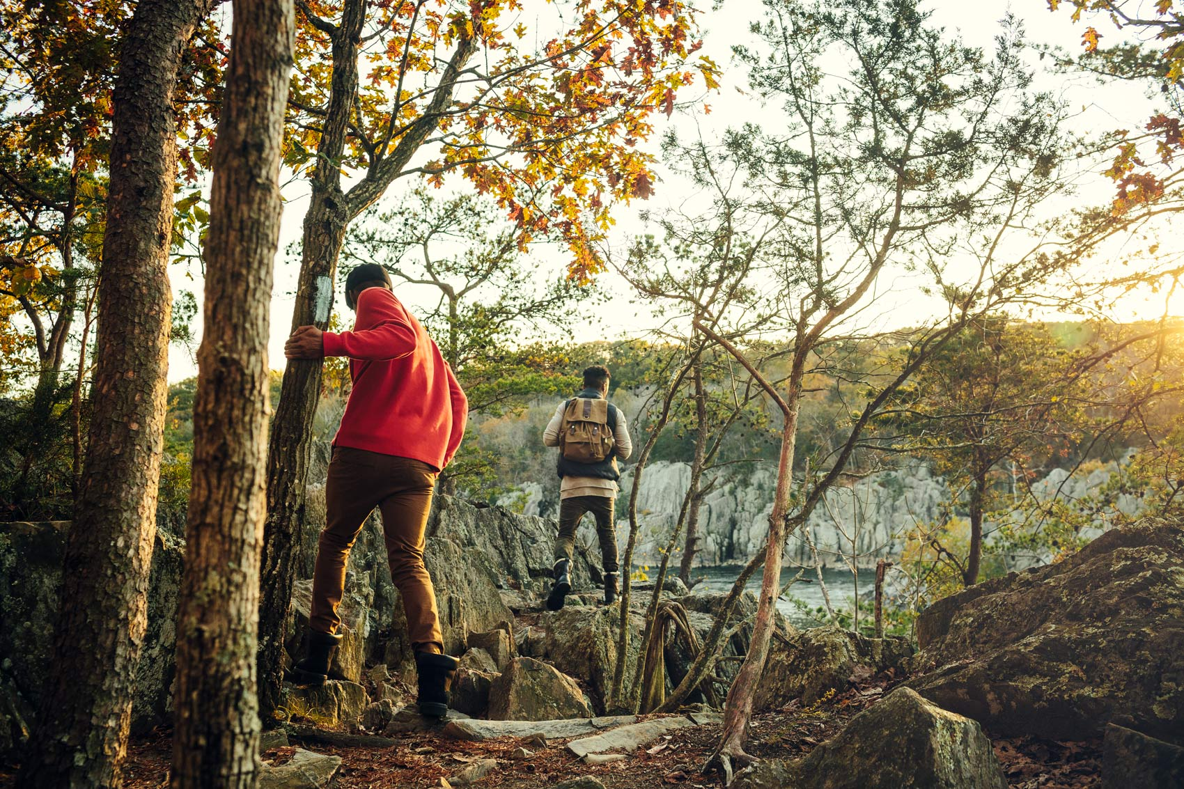 two men hiking on cliff for washington dc commercial photography