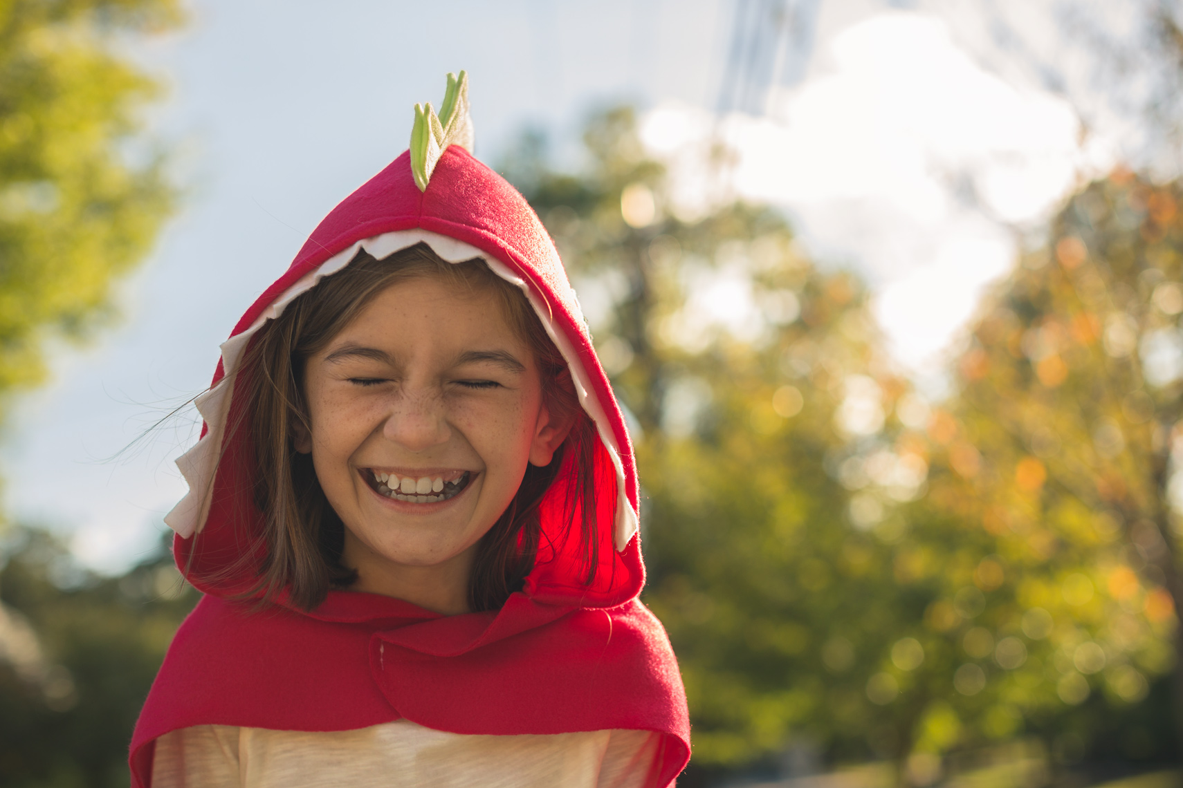 girl laughing in red halloween costume for washington dc commercial photography