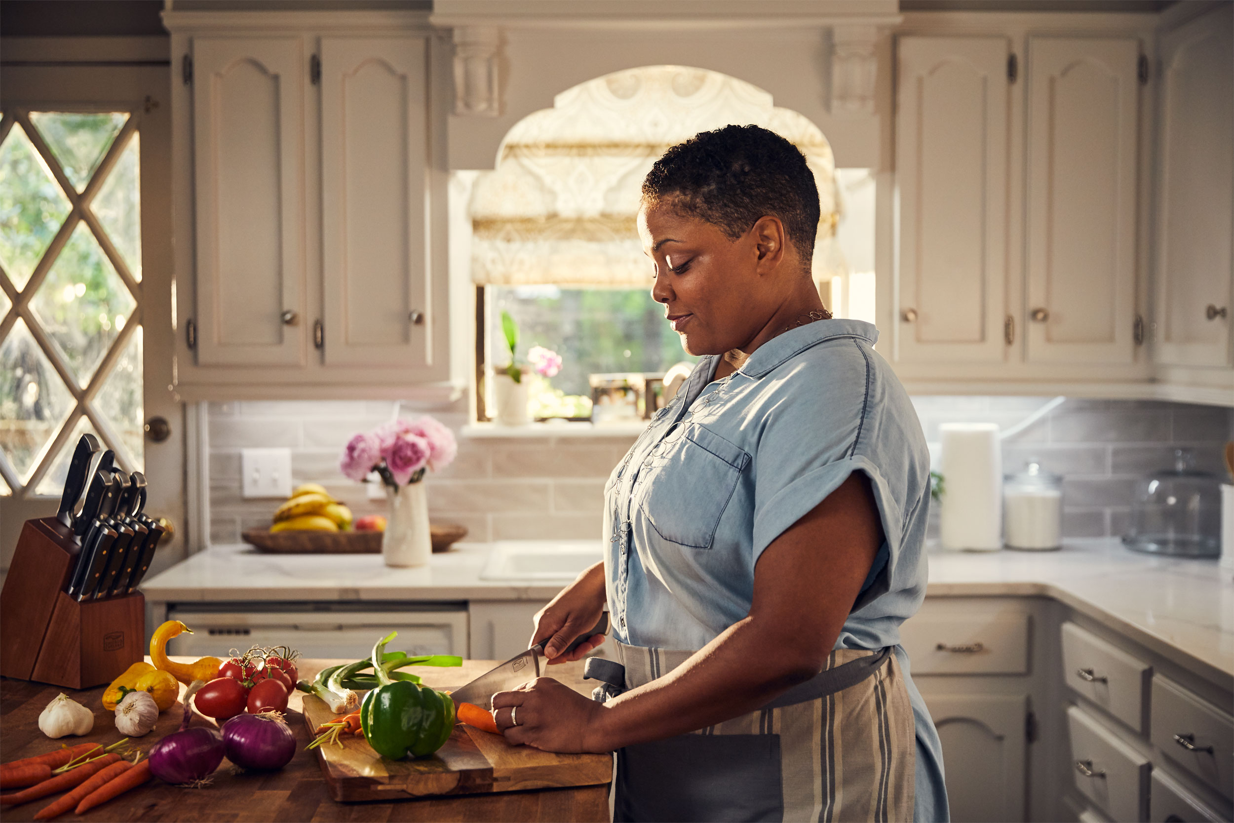 woman chopping vegetables in kitch, washington dc commercial photography