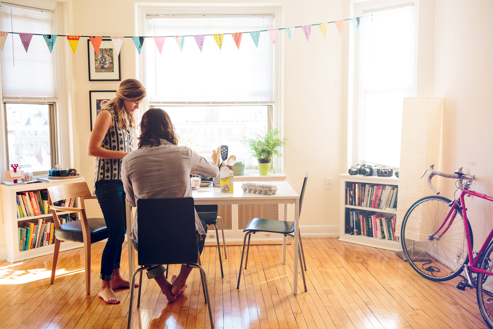 young man and woman sit at table in apartment for washington dc commercial photography