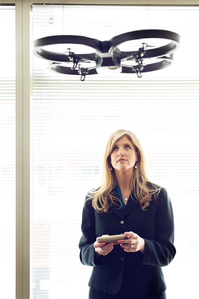 lisa ellman flying drone in office for washington dc editorial photography