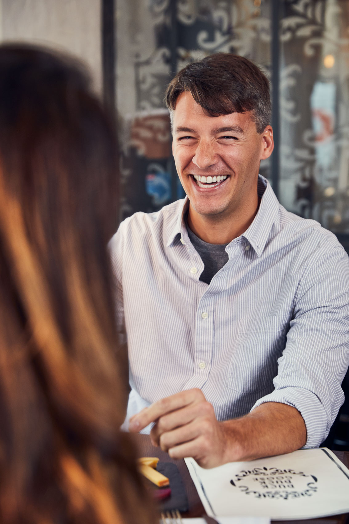 man laughing on date at restaurant, washington dc commercial photography