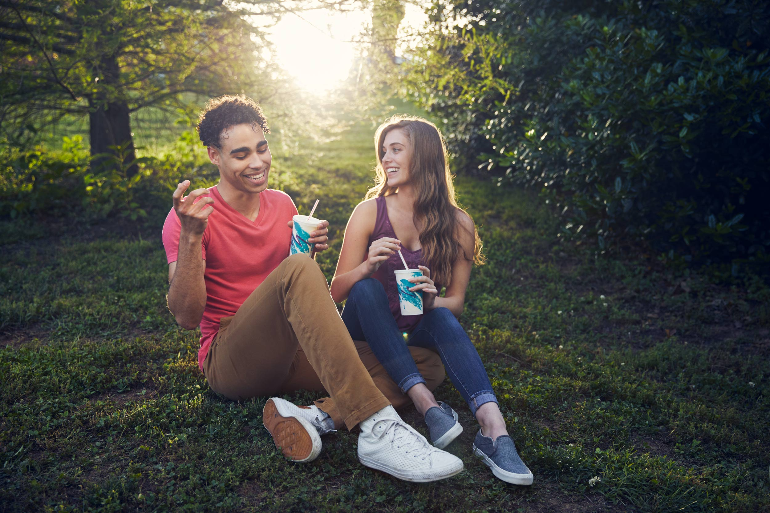 millennials sharing milkshake in park for washington dc commercial photography