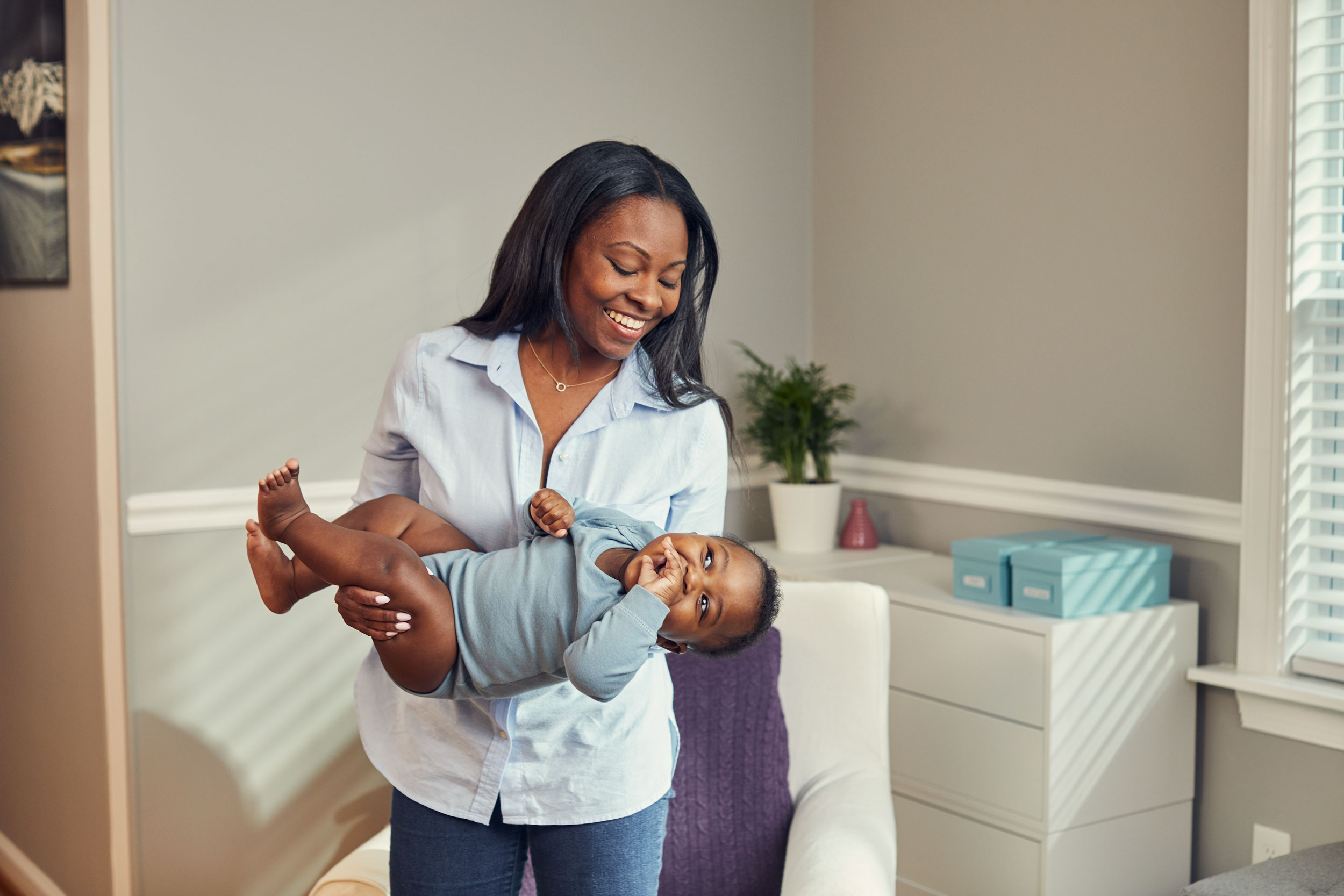 mom swinging baby in room, washington dc commercial photography