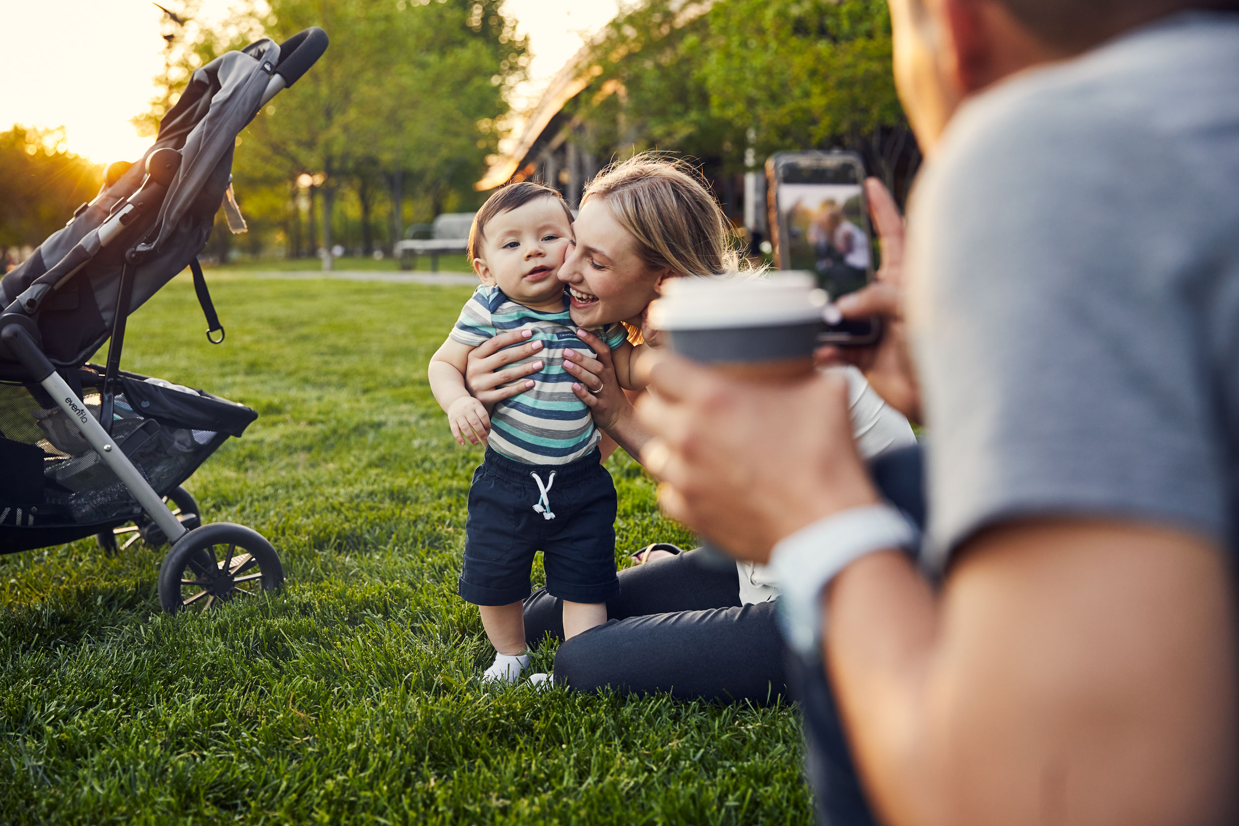 mom hugging baby in smartphone photo for washington dc commercial photography