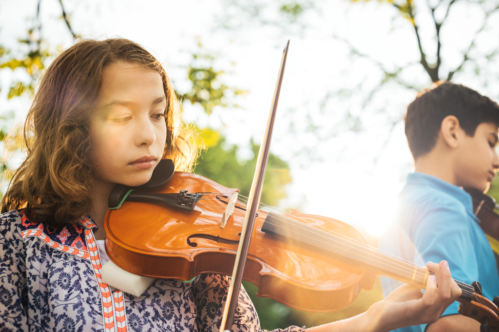 adolescent girl playing violin outside, washington dc commercial photography