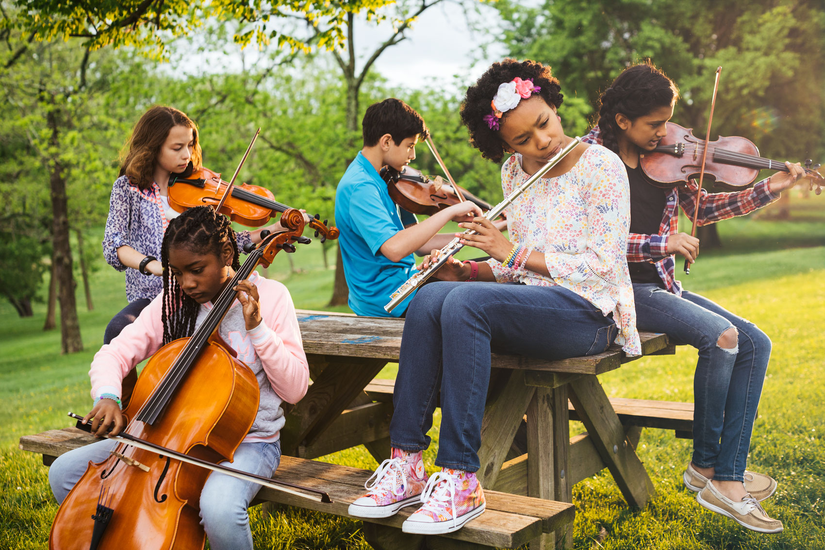 group of kids playing musical instruments on picnic table, washington dc commercial photography
