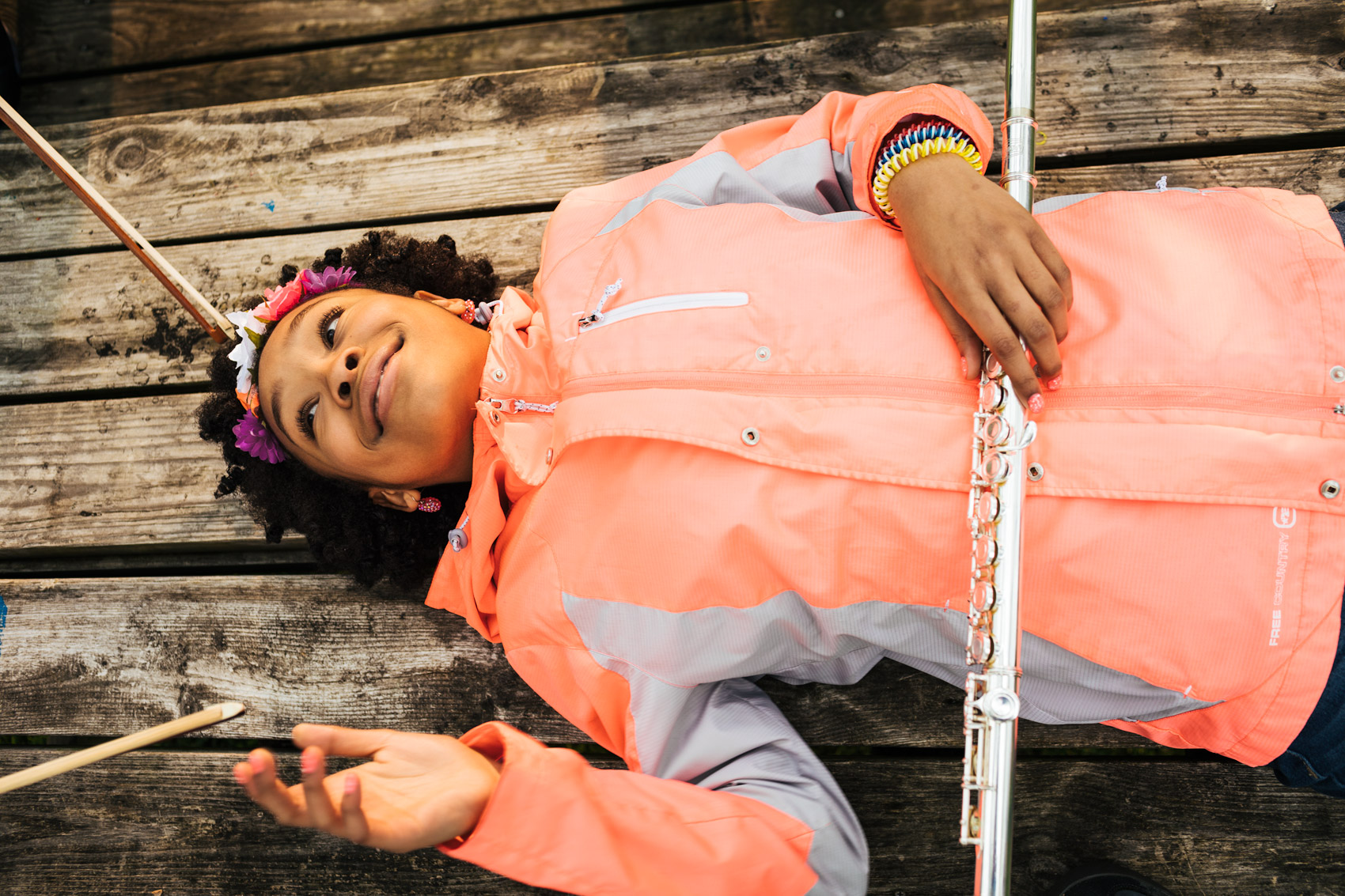 girl lying on table with flute, washington dc commercial photography