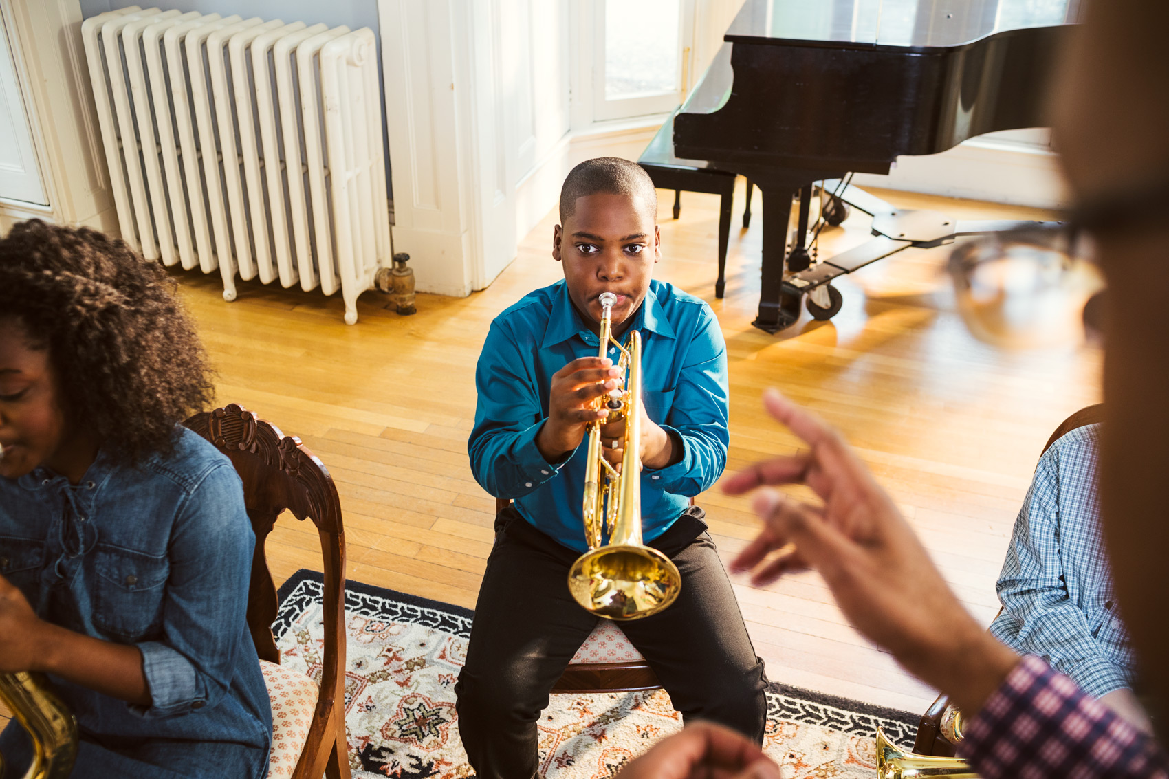 young trumpet player in music lesson, washington dc commercial photography