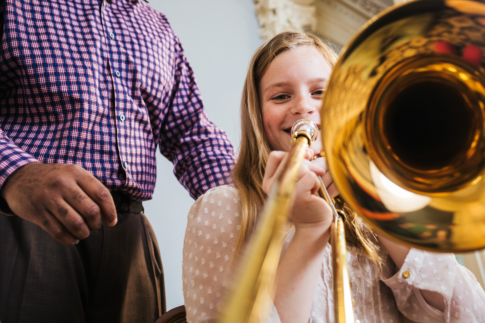 tween girl trombonist in music lesson, washington dc commercial photography