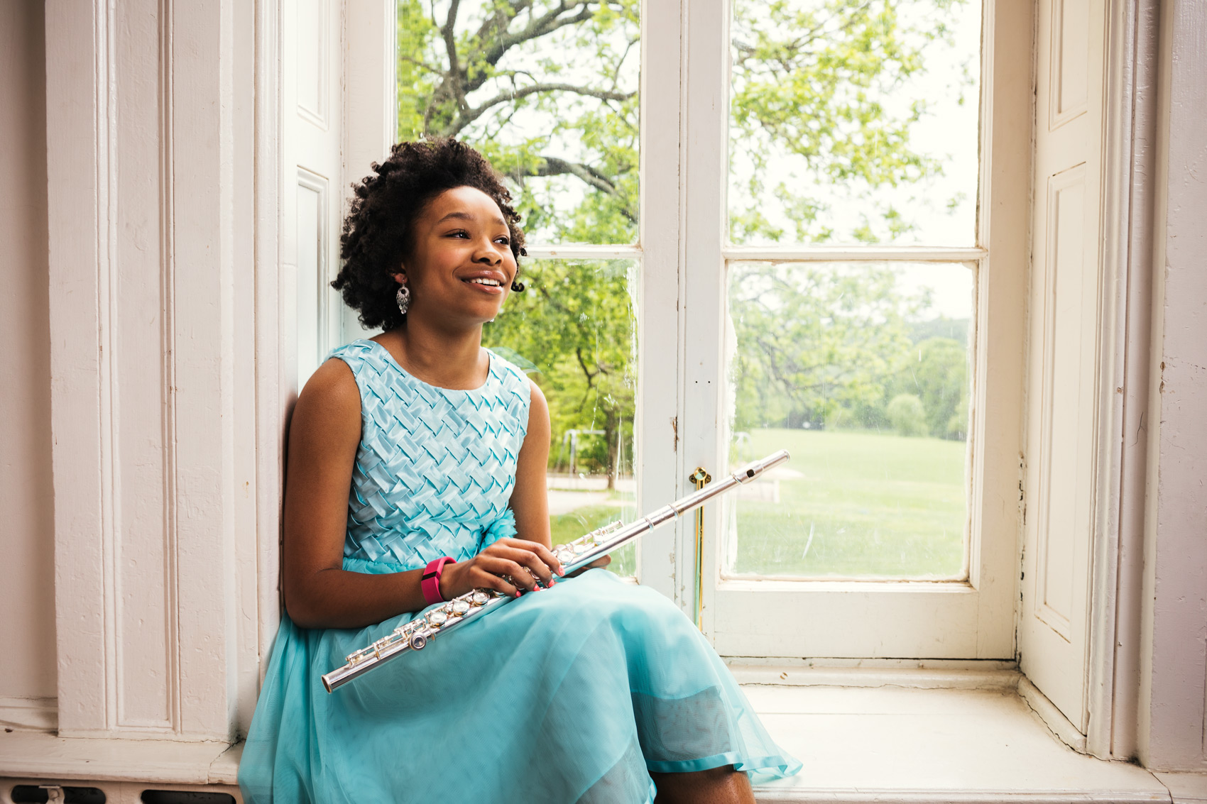 young flutist sitting on windowsill, washington dc commercial photography