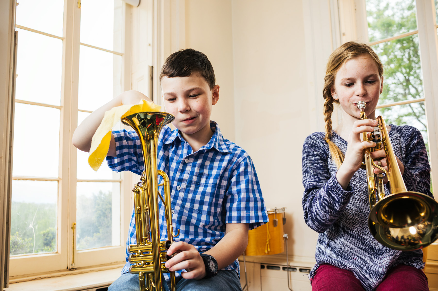 two kids preparing for music lesson in room, washington dc commercial photography