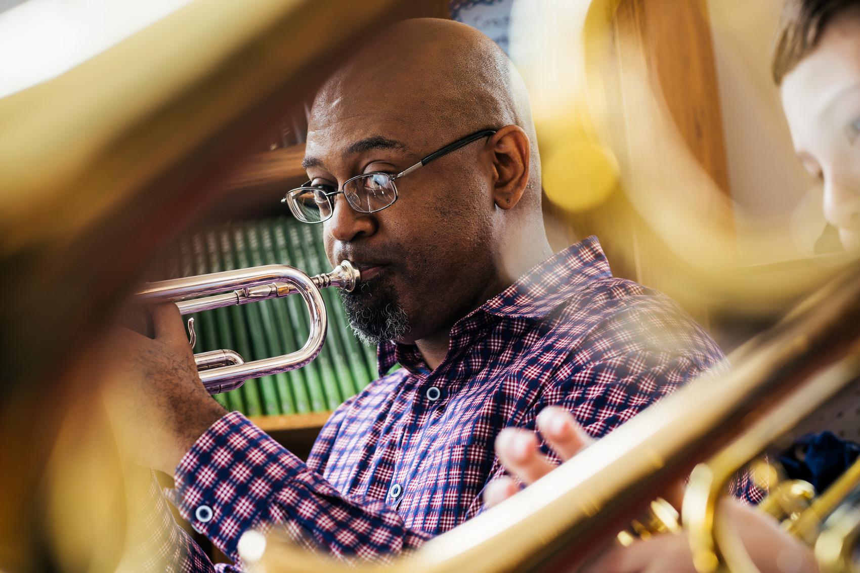 music teach playing trumpet behind horns, washington dc commercial photography