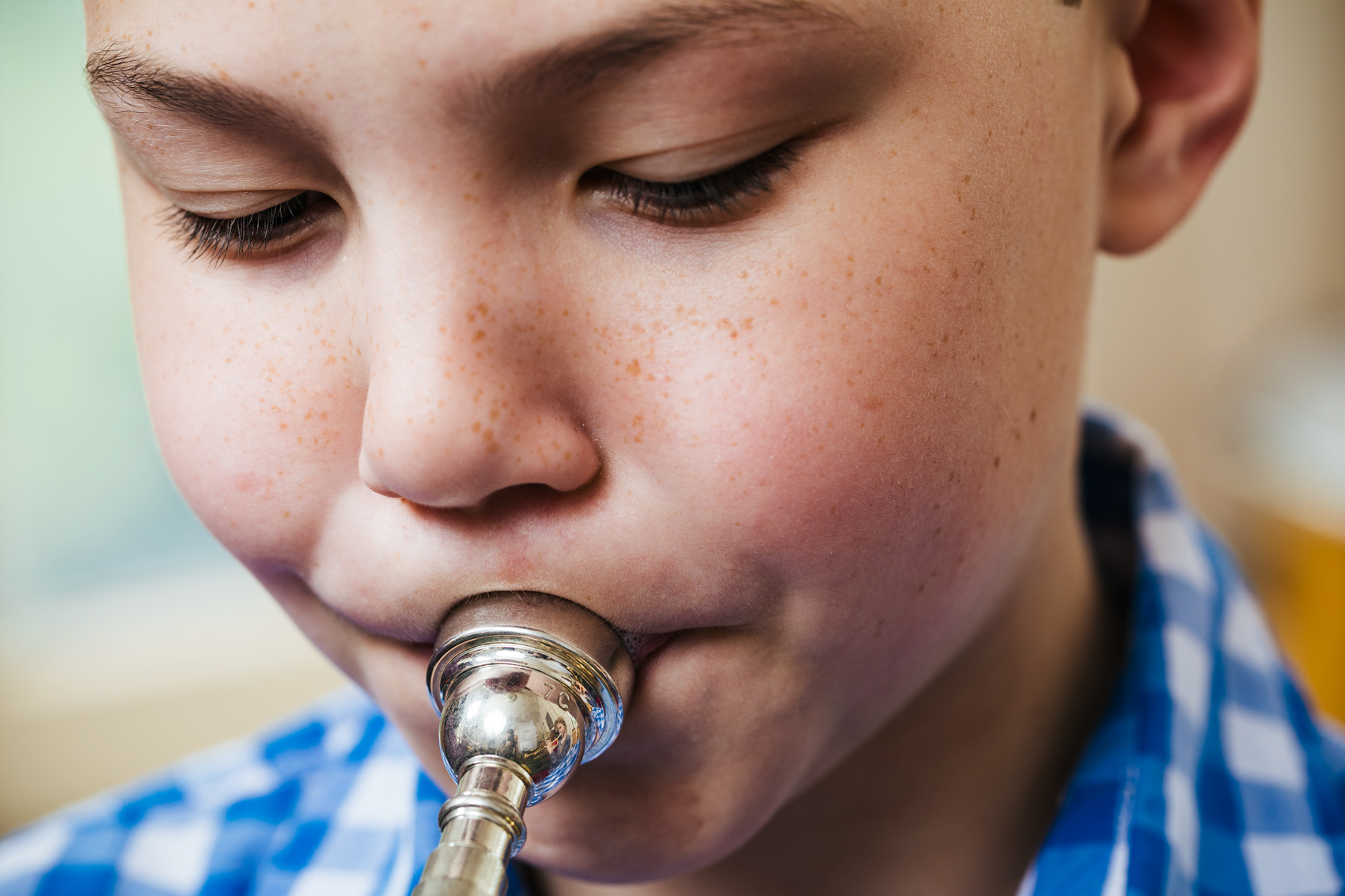 young male trumpet playing blowing horn with big cheeks, washington dc commercial photography