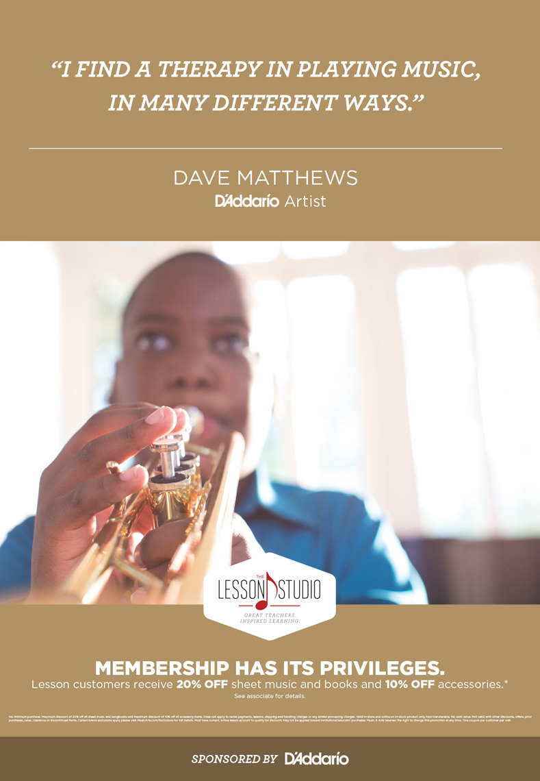 boy playing trumpet by window for music & arts advertisement, washington dc commercial photography