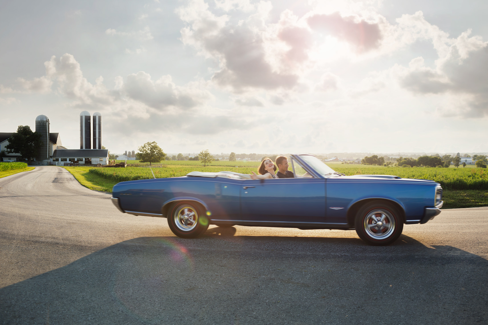 couple in pontiac gto driving on farm road for washington dc lifestyle photography