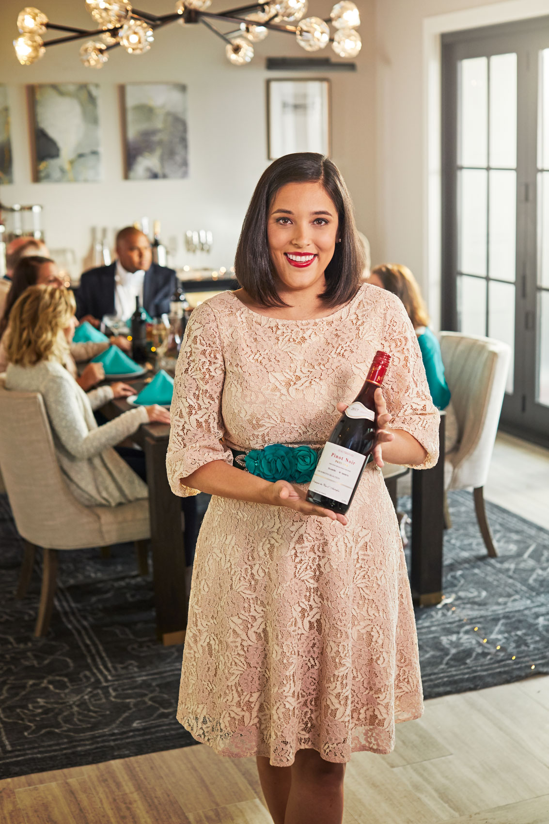 host holding bottle of wine for portrait, washington dc commercial photography