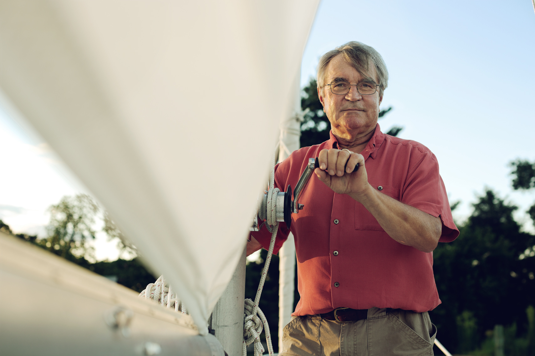 old man standing on sailboat for washington dc editorial photography