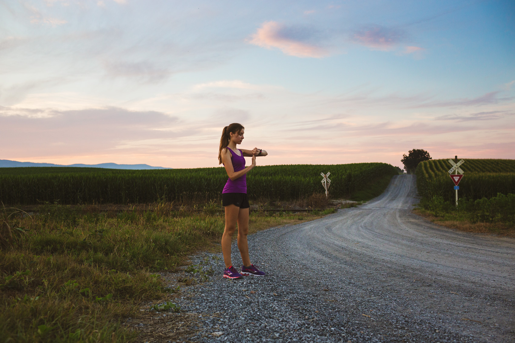 runner checking fitness tracker on farm for washington dc commercial photography