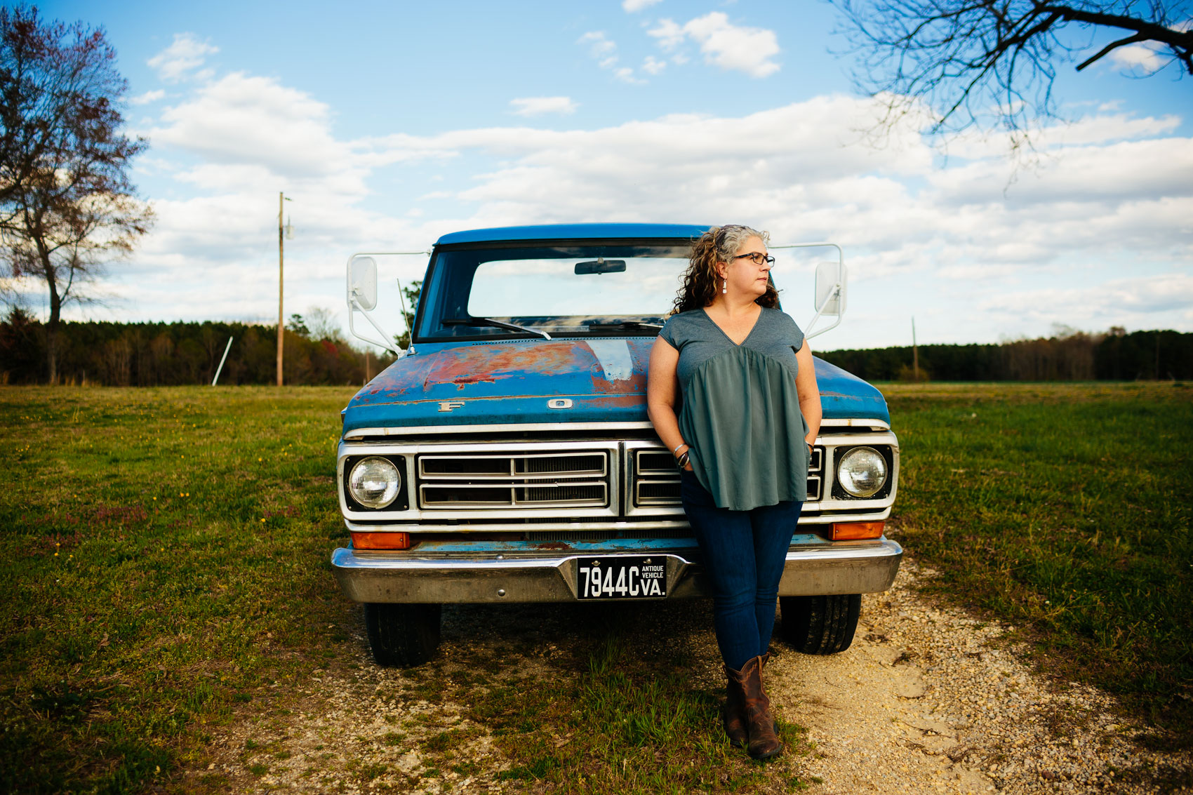 portrait of woman with vintage ford truck