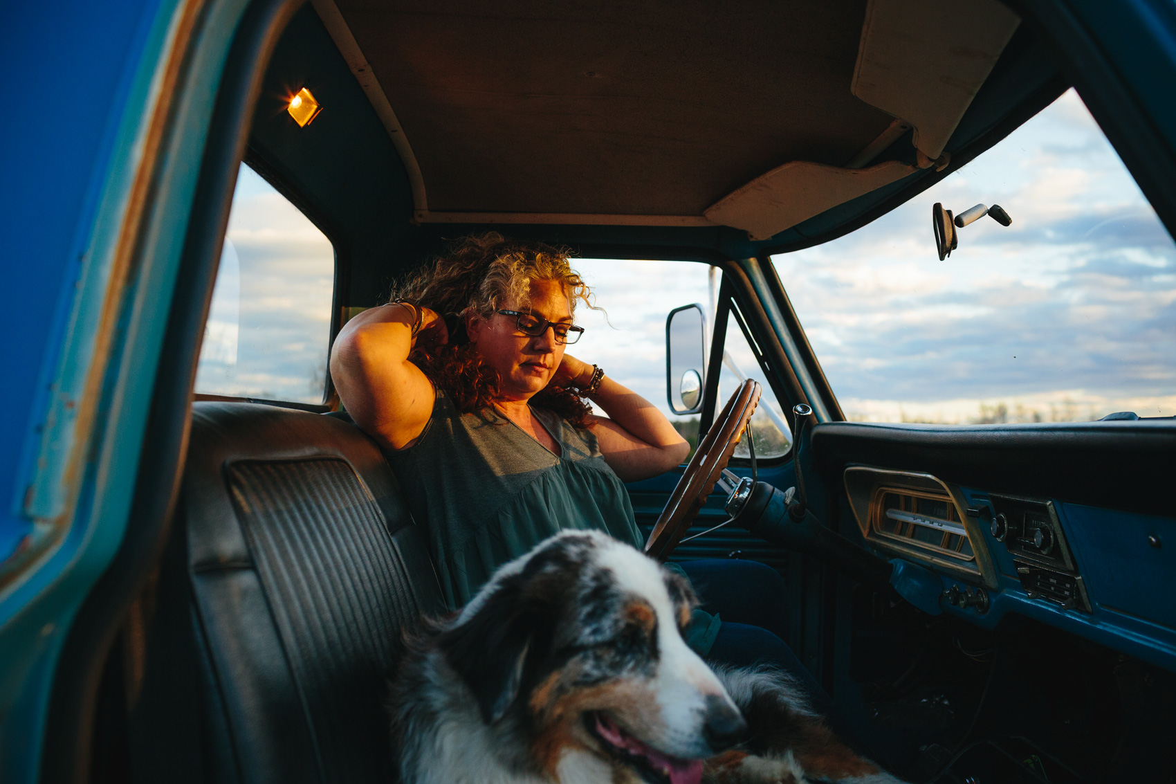 woman with gray streak in truck with dog, washington dc commercial photography