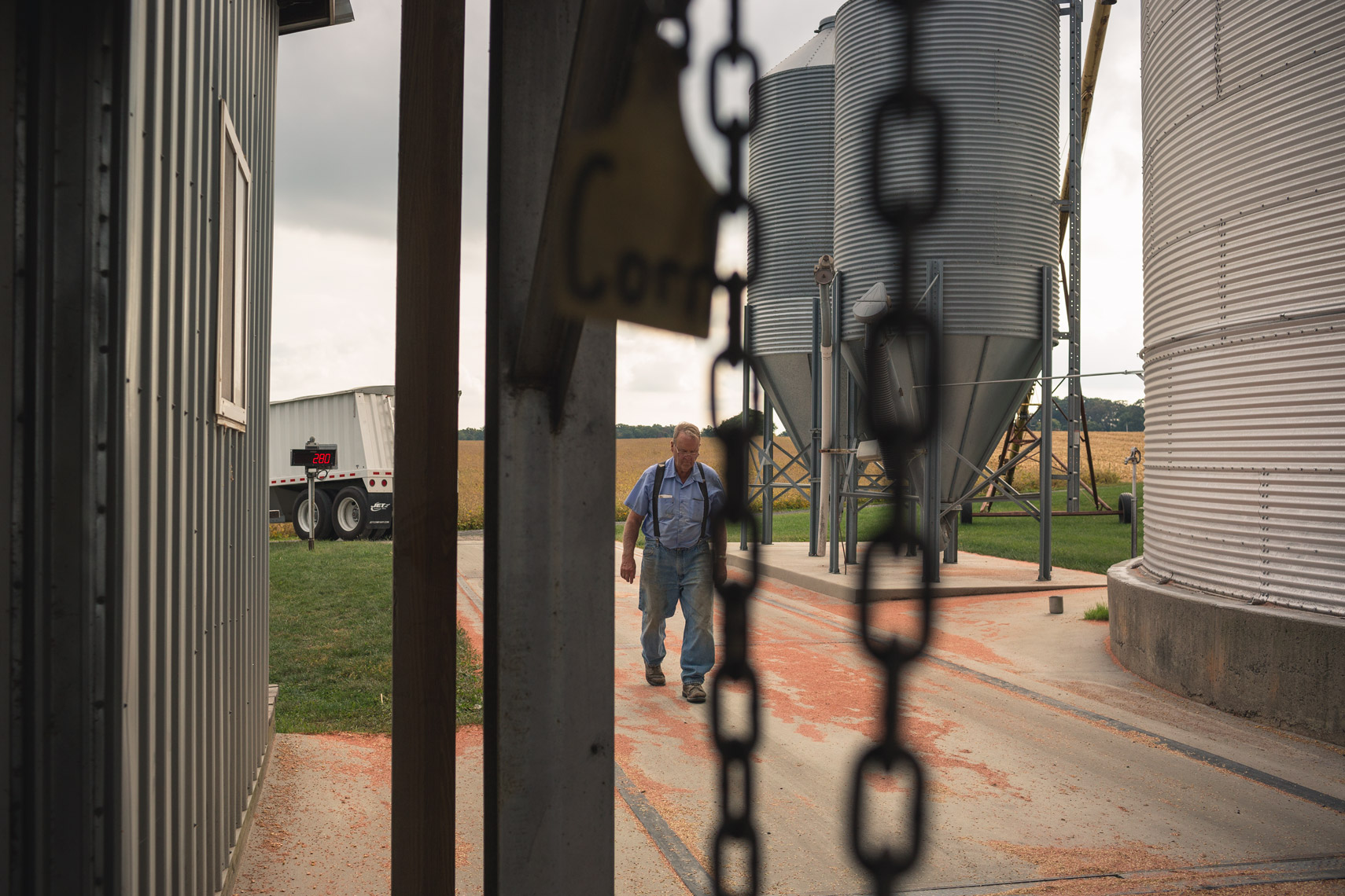 farmer walking by grain silos for washington dc industrial photography