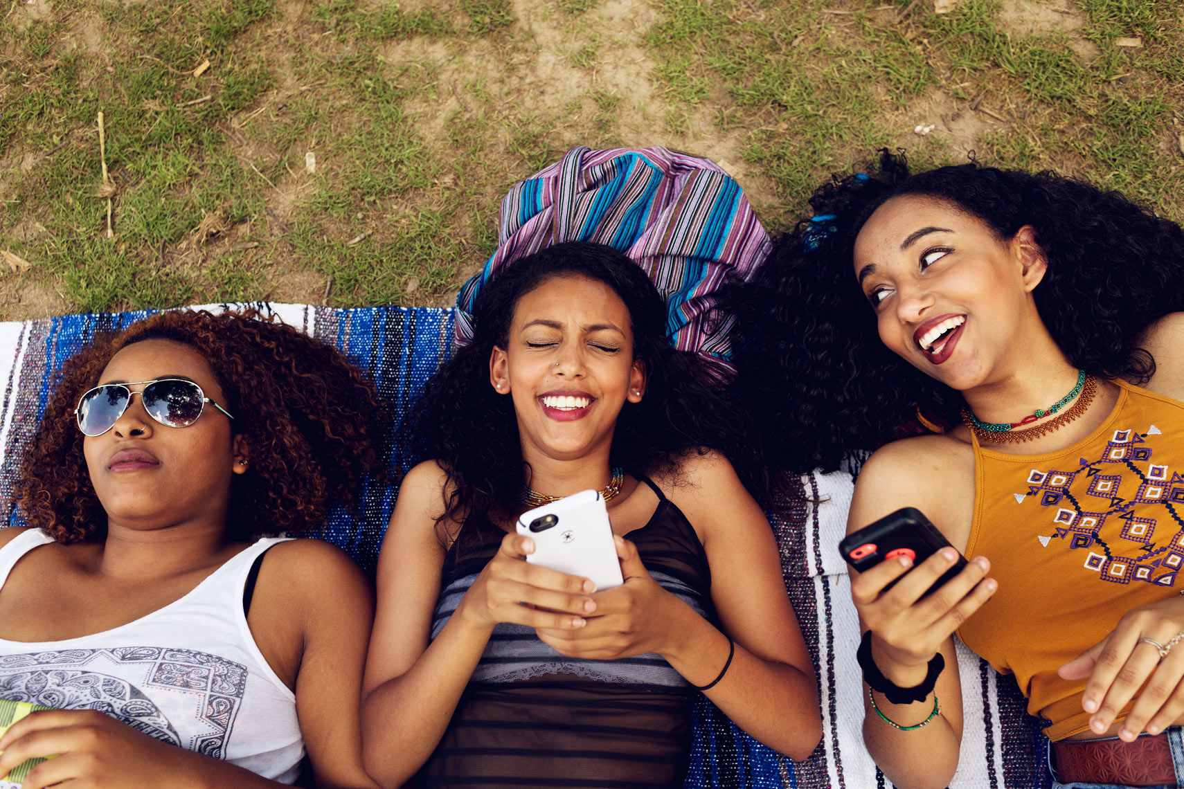 millennial women with smartphones laughing for washington dc commercial photography