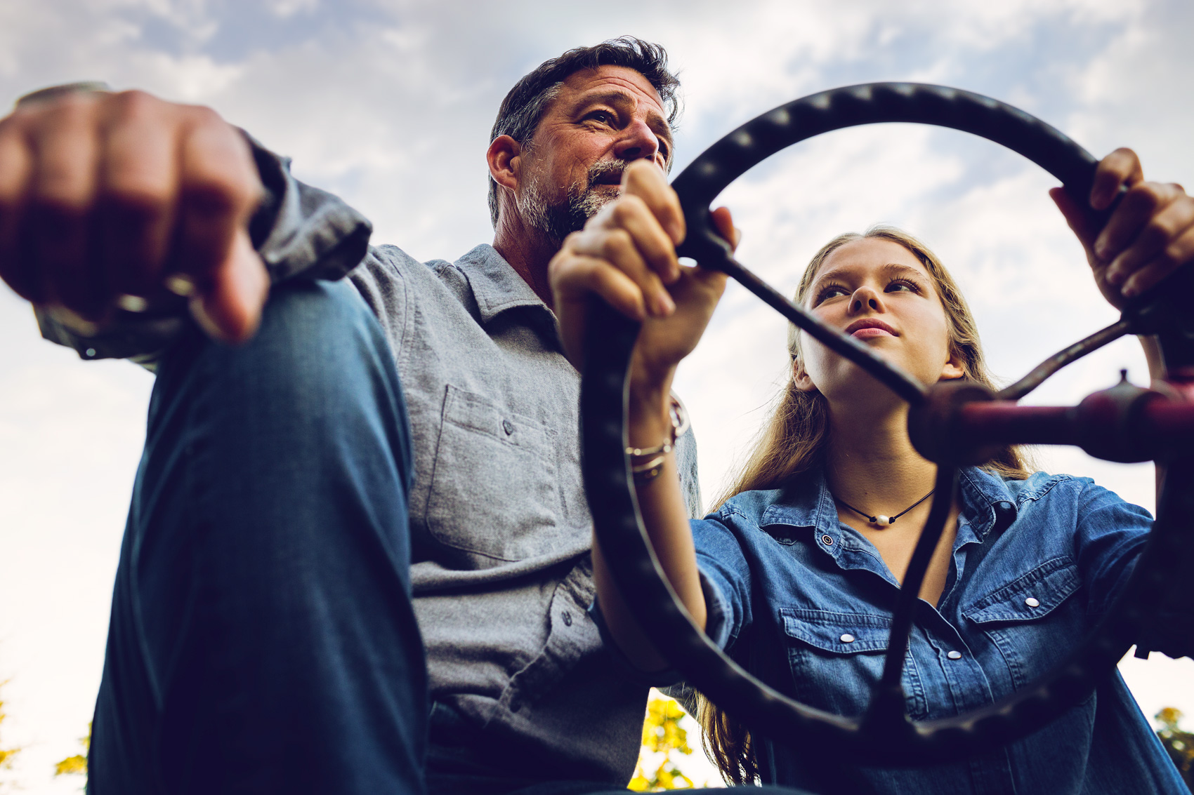 dad gives daughter tractor driving lessons for washington dc commercial photography